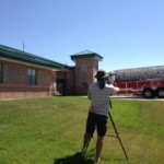 A Colorado news reporter shoots footage of the newly-installed lightning protection system on South Metro Fire Station #45.  LPI member firm, Mr. Lightning provided the installation at no charge and ECLE donated the materials.